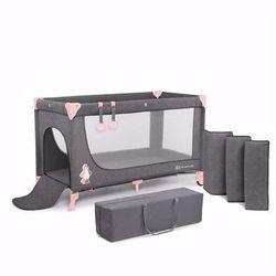 Łóżeczko turystyczne Joy z różowymi elementami Kinderkraft