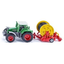 Traktor z deszczownicą szpulową